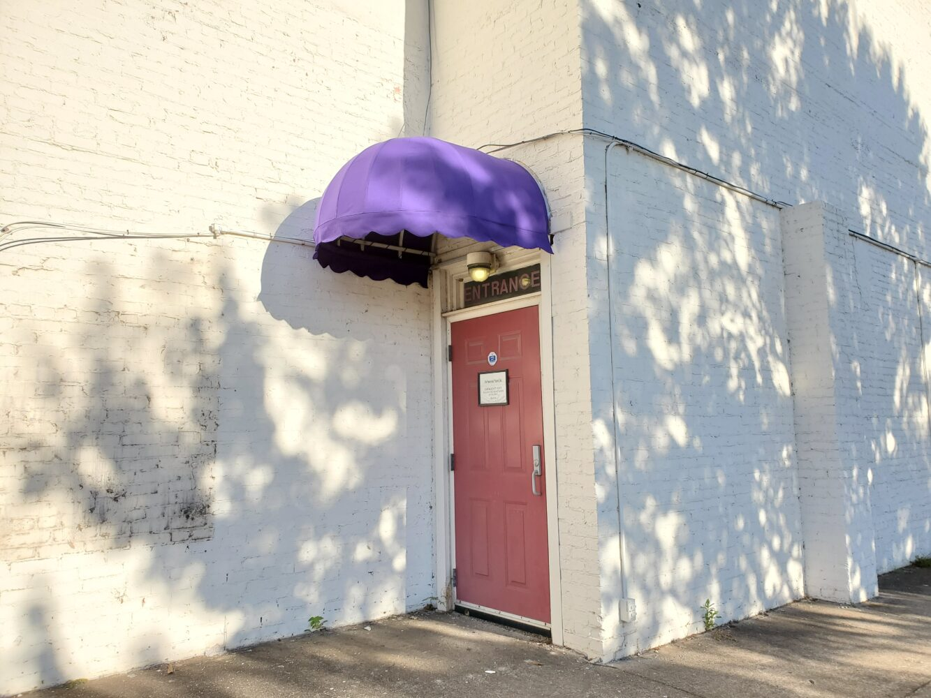 Custom built awning for Legion Theatre in purple Sunbrella Canvas